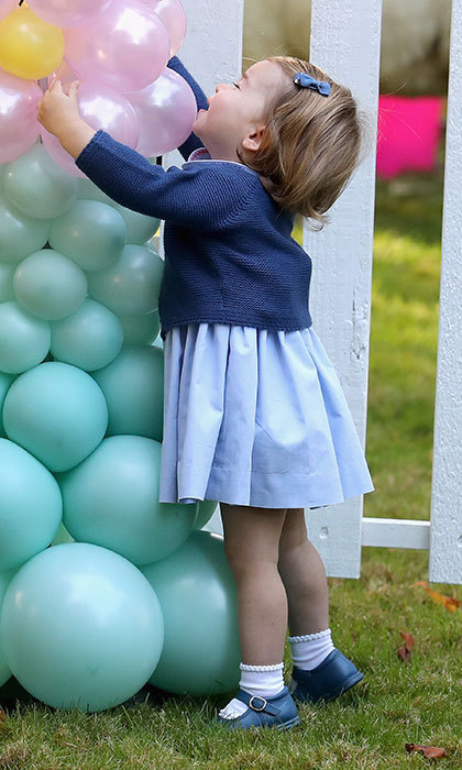 "September 2016: ""Pop!"" the little princess said, pointing at the balloons while her big brother George looked around asking for ""Mummy."" This was Princess Charlotte's first-ever engagement at Government House in Victoria while on tour in Canada