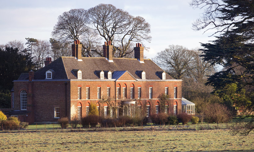 It's at Anmer Hall, the Cambridge's country home in Norfolk, where Charlotte will be able to live a more normal life and attend school nearby like her brother. 