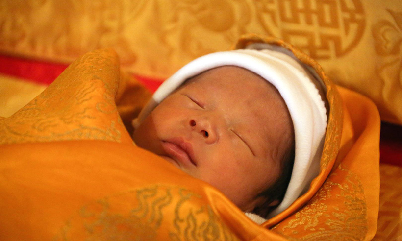 "Four days after his birth, King Jigme posted the first portrait of his baby boy on Facebook, with the caption, ""Bhutanese families spent a wonderful Losar today, celebrating the day with family and loved ones. To make the day even more special, we have the honour of bringing to you the very first official photograph of His Royal Highness The Gyalsey."" 
