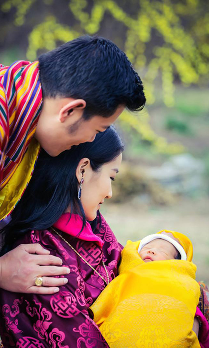 The new parents gazed lovingly at their four-day-old prince as he rested peacefully in the arms of his mother. 