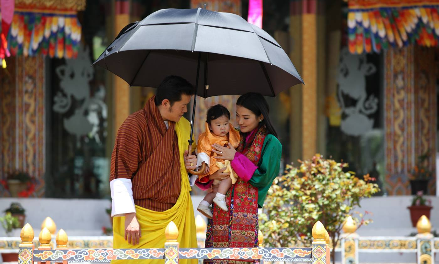 The royal trio pose at the consecration ceremony of the Guru Nangsid Zilnon Phodrang in Aug. 2016. 