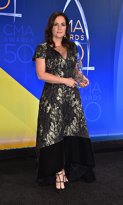 Lori McKenna wore a short-sleeved, A-line dress with gold detail and a velvet hem.