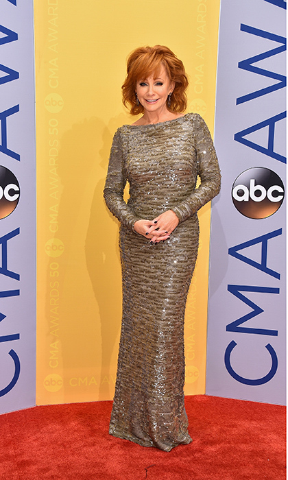 Reba McEntire was the belle of the ball in an embellished floor length gold gown.