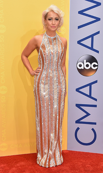 Meghan Linsey wore a bejeweled halter gown by Johnathan Kayne.
