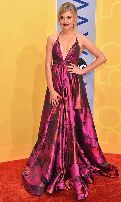 Kelsea Ballerini stunned in a magenta Michael Costello dress with a plunging neckline. 