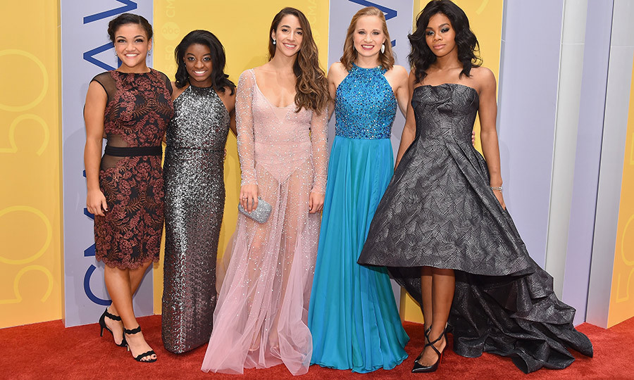 Team USA gymnasts Laurie Hernandez, Simone Biles, Aly Raisman, Madison Kocian and Gabby Douglas traded in their leotards for gorgeous gowns. 