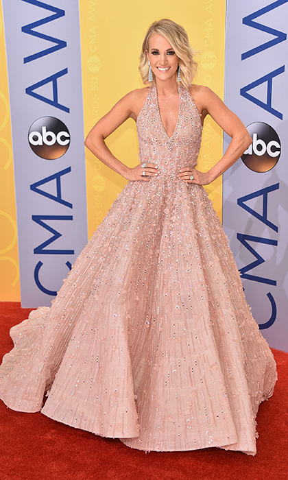 Carrie Underwood looked stunning in a pink Michael Cinco gown embellished with Swarovski crystals and pearls. She accessorized with Butani diamond earrings and diamond rings by Harry Kotlar and Hearts on Fire.