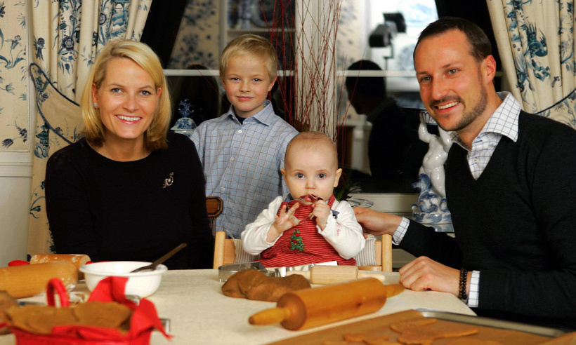Here, 11-month-old Princess Ingrid and her brother Marius make Christmas cakes with their loving parents. 