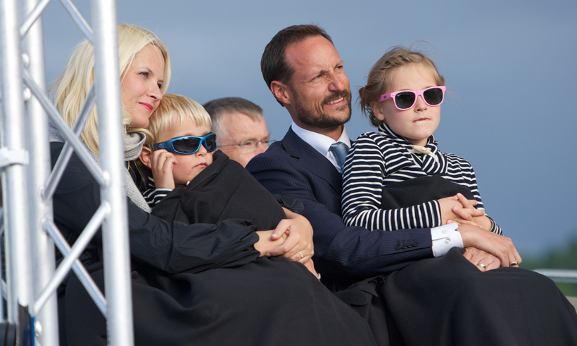 The family snuggled up at King Harald and Queen Sonja's 75th birthday celebrations at Oslo Opera House in 2012. 