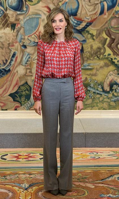 Queen Letizia looked stylish and sophisticated in a checked blouse and tailored trousers.