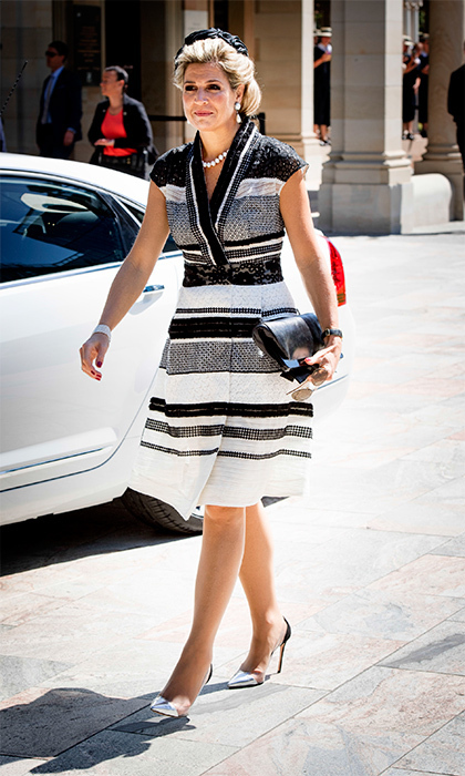 For a day out in Brisbane, the stylish royal wore a black and white Claes Iversen wrap dress with a black silk hat. 