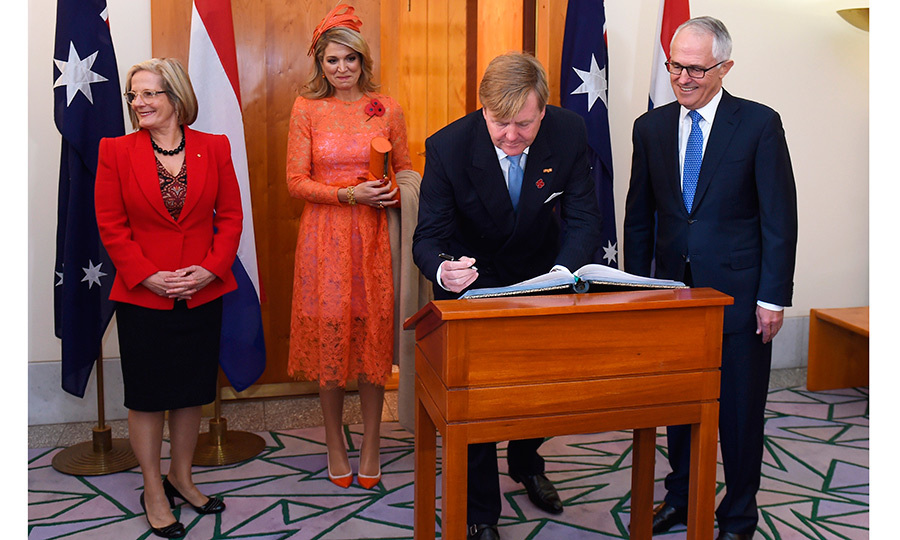 All eyes were on the lace-clad mother of three as she joined her husband and Australia's Prime Minister Malcolm Turnbull, right, and his wife Lucy, left, at Parliament House in Canberra. 