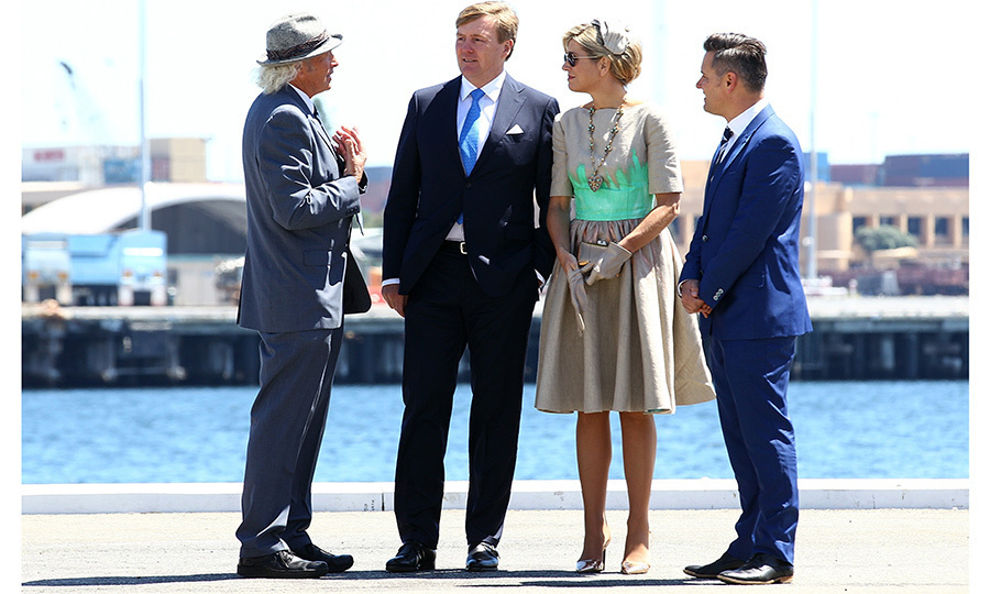At Victoria Quay in Fremantle, Australia, Queen Maxima paired a hand-painted linen Mattijs van Bergen dress with a statement necklace featuring a heart-shaped pendant. 