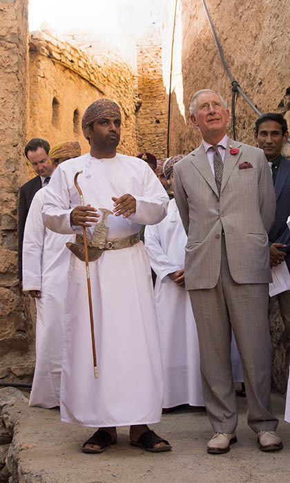 A representative from the Ministry of Tourism took the Prince of Wales on a walking tour of the  200 year-old village of Misfat Al Abriyeen.