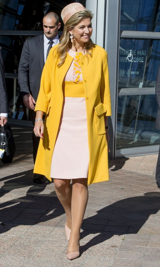 Maxima wore vibrant yellow and pastel pink for a meeting with the Dutch community in Christchurch, New Zealand on Nov. 8.