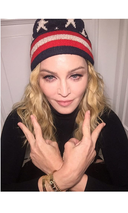 Madonna, who surprised fans with a live acoustic show in the middle of NYC, posted this picture in her election gear with the caption: 'Meet me in Washington Square Park at 7:30 Let's Go Hard For Hillary Clinton!'