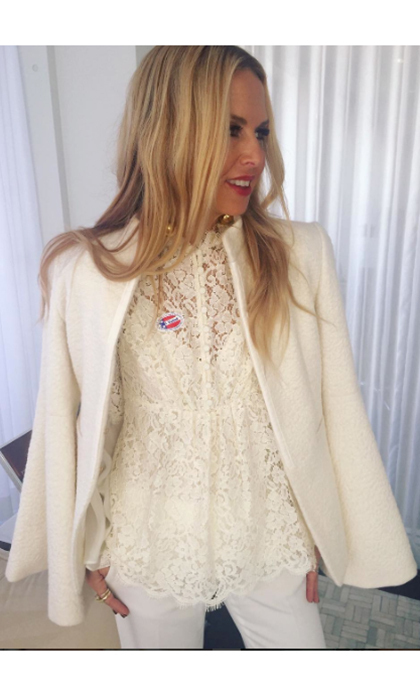 Rachel Zoe gave her cream outfit a pop of color with her 'I voted' pin. She captioned the snap, 'Tomorrow is election day and you know what that means  I voted and so should you ❤️ XoRZ'