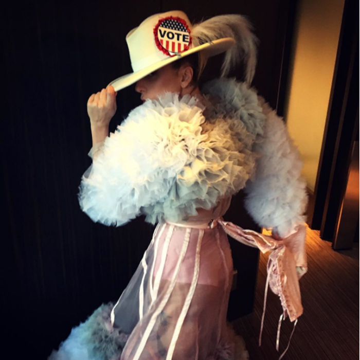 You can't miss Lady Gaga's oversized 'Vote' sticker on her cowboy hat!