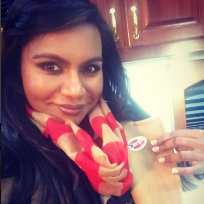 Mindy Kaling popped her collar and showed off her sticker. 