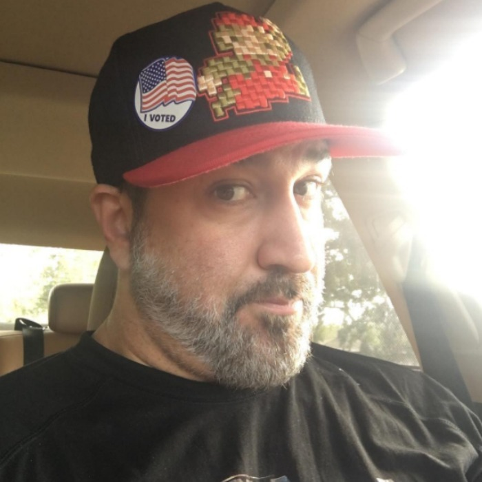 "Joey Fatone showed off his cool hat and ""I Voted"" sticker. 