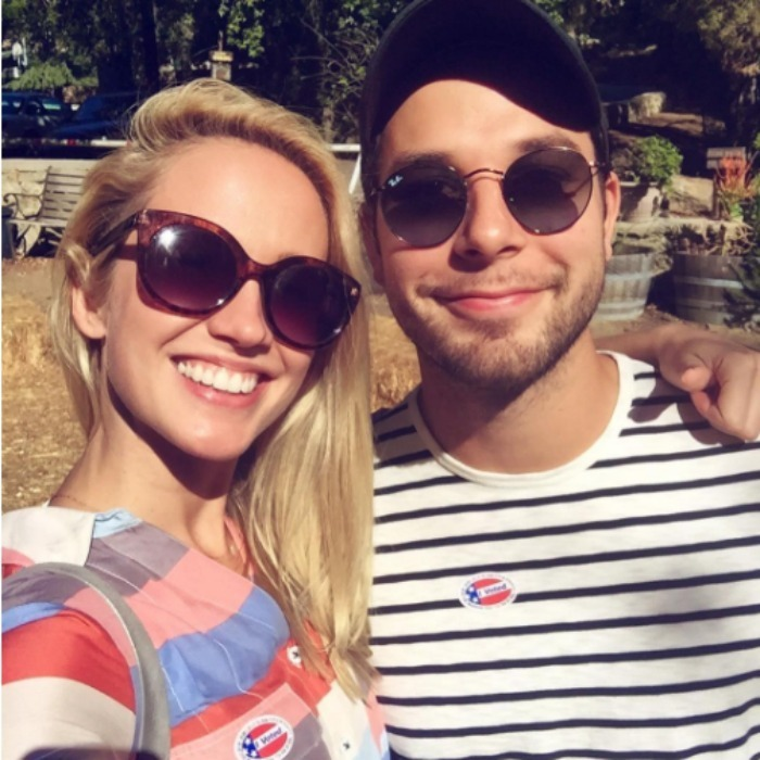 "Newlyweds Skylar Astin and Anna Camp were cool in their sunglasses and ""I Voted"" stickers. 