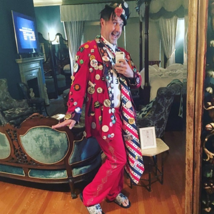 "David Arquette didn't prove he voted with a sticker. The actor showed off his wacky red, white and blue attire, complete with past presidential election pins to ""fire up the millennials."" 