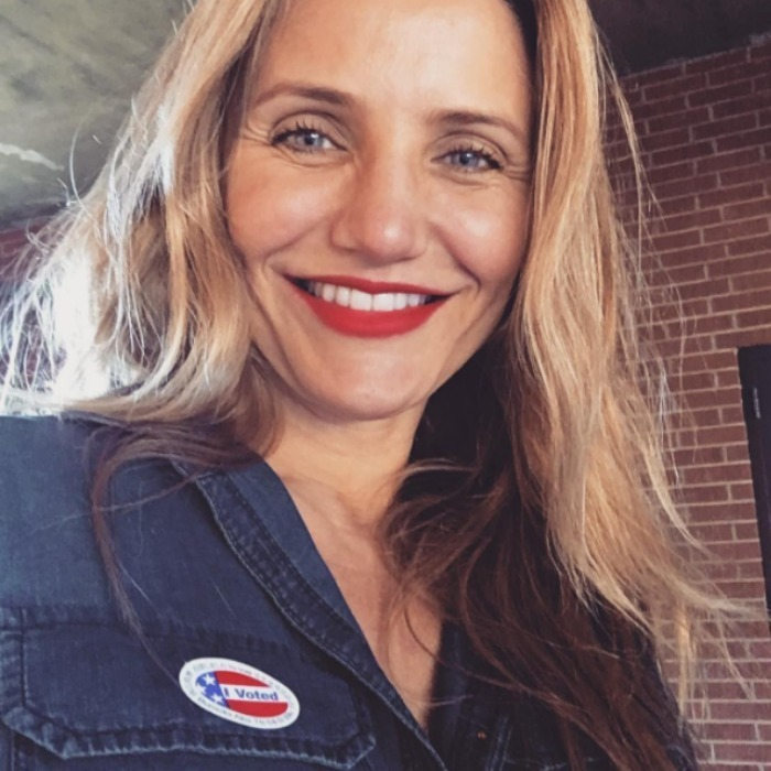 "Cameron Diaz's red lipstick matched her ""I Voted"" sticker. 