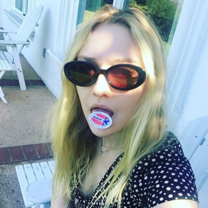 "Dakota Fanning tasted her ""I Voted"" sticker in her post-voting selfie. 