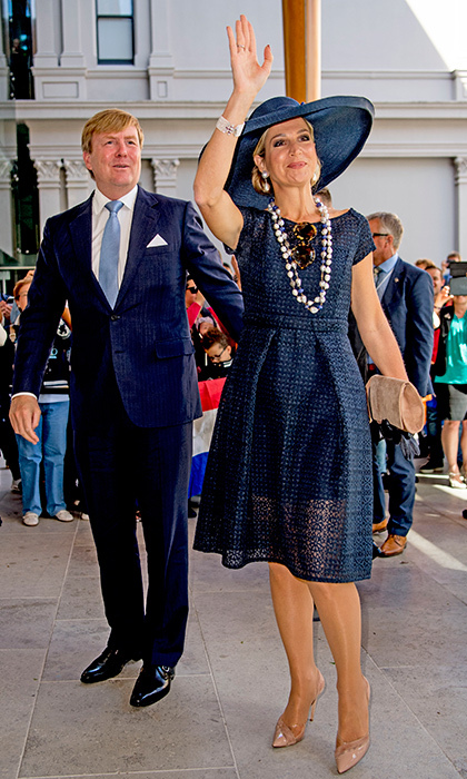 For a visit to the Auckland Art Gallery, the mother of three dazzled in a navy eyelet dress with a matching wide-brim hat.  