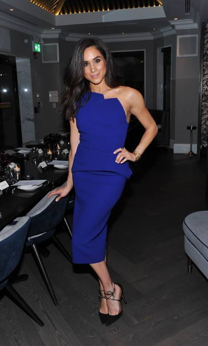 Embracing the cold shoulder trend in this electric blue dress.