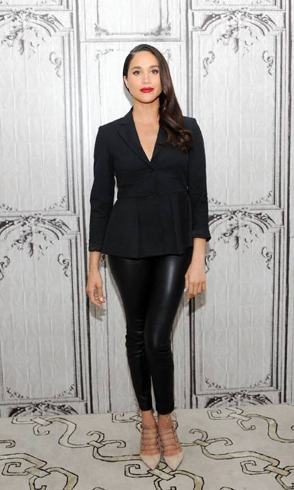 Meghan put a twist on the Suits suit, pairing a tailored blazer top with sexy leather look leggings.
