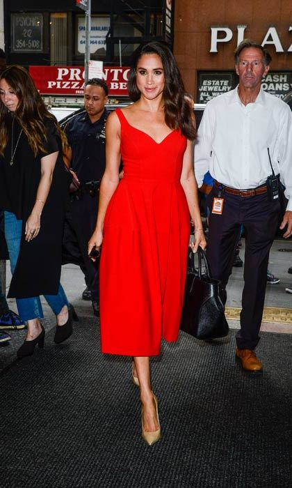 Red hot! It was all eyes on Meghan simple 1950s-inspired dress with full skirt.