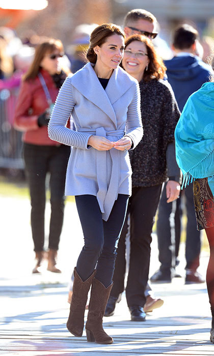 While on her royal tour of Canada, the Duchess of Cambridge kept warm in a pretty grey topper by Sentaler, which featured a belted waistline and ribbed sleeves.
