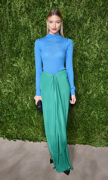 Model Martha Hunt was resplendent in a two-tone aqua and turquoise Tome gown with pointy black heels and a matching clutch at the CFDA Vogue Fashion Fund dinner in New York. <p>Photo: © Getty Images</p>