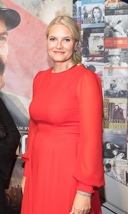 Mette-Marit gave a sartorial nod to her host nation in a red dress.