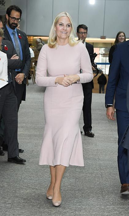 Princess Mette Marit donned a long-sleeved nude midi dress to carry out an engagement in Canada.
