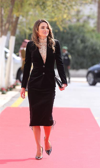 Looking elegant as ever, Queen Rania attended the State opening of the Parliament in Jordan wearing a black skirt suit and lace blouse.