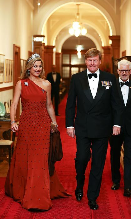 Máxima glammed up for a state dinner in New Zealand wearing a one-shoulder red gown.