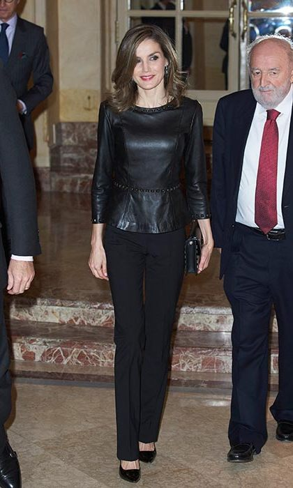 Queen Letizia added a stylish twist to her all-black ensemble with a studded leather peplum top.