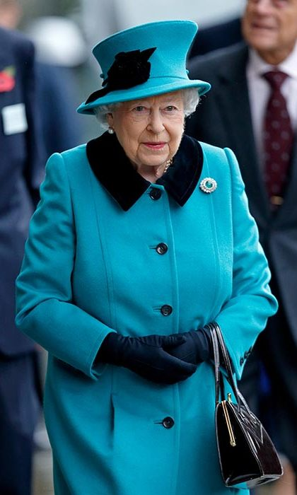The Queen wore a vibrant blue coat with black collar for an engagement in London on Wednesday.
