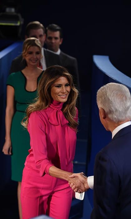 For the second TV debate, Melania stood out in a vibrant pink pussy bow blouse and matching trousers from Gucci.