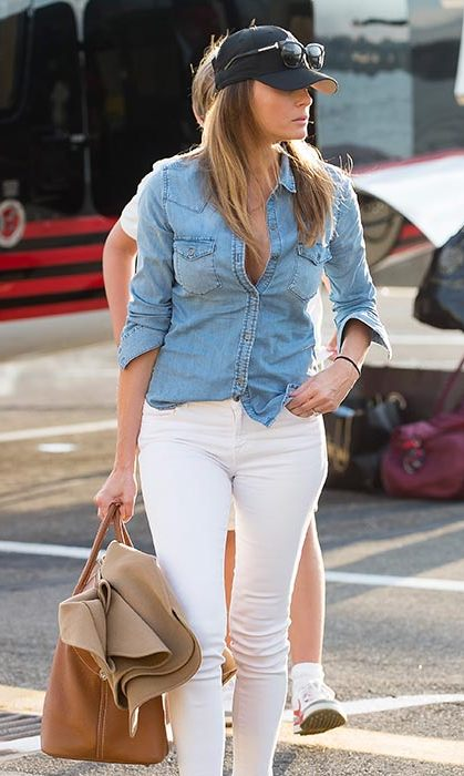 A rare dressed down outing in a denim shirt and white skinny jeans.