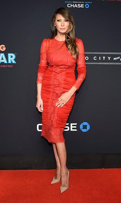 Melania teamed her ruched red dress with nude pointed courts.