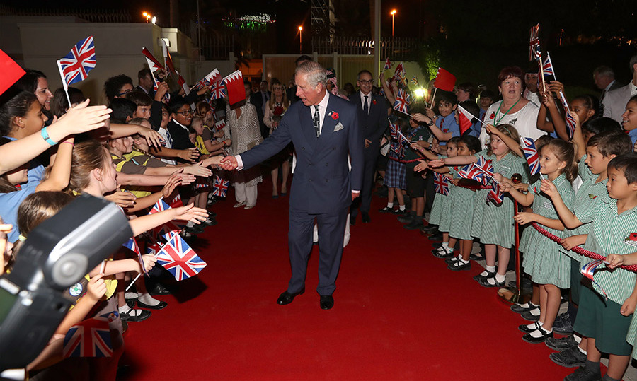 The Prince of Whales was greeted by school childen as he attended a reception at the British Embassy on Nov. 10 in Bahrain.