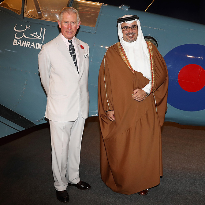 The Prince of Wales and Prince Salman bin Hamad bin Isa Al Khalifa pose next to a Spitfire at the Bahrain Museum on day 3 of a Royal tour of Bahrain.