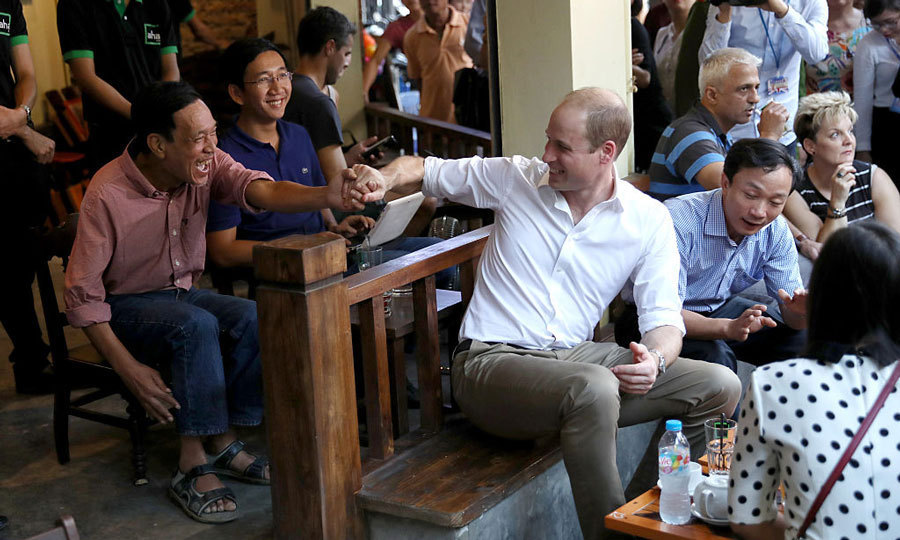 William shook hands with an excited local during his visit to Aha Cafe, where the royal was joined by conservation supporters. 