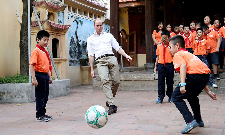 Bend it like Beckham! The Prince showed off his soccer skills, playing a game with students at a nearby school. 