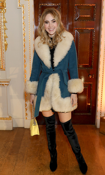 Suki Waterhouse made a haute statement in thigh-high velvet Stuart Weitzman boots paired with a suede Burberry coat at the Stuart Weitzman boutique opening in London.