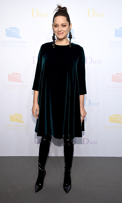 Marion Cotillard was holiday party-ready in a green velvet Christian Dior gown with latex over-the-knee boots and drop earrings at the 2016 Guggenheim International Gala Pre-Party.
