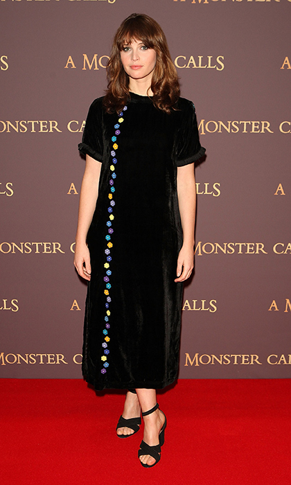 Felicity Jones donned a playfully embellished Jupe by Jackie velour dress at a London screening of <em>A Monster Calls.</em>
